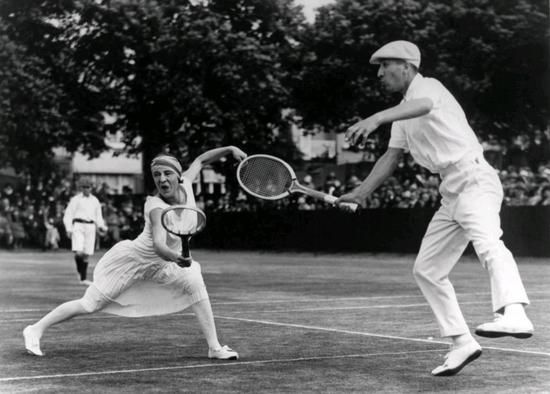 Lots of captions identify Suzanne Lenglen's doubles partner in this 1925 photo as Rene Lacoste, but it's actually another of the Four Musketeers, Jean Borotra, playing in his trademark blue beret. Lenglen and Borotra went on to win the 1925 Wimbledon Championship Mixed Doubles title.