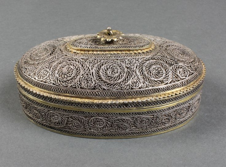 "Lot 518, A Persian silver filigree oval trinket box with rosette handle, 236 grams  5"", sold for £280"