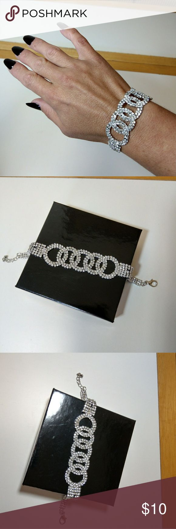 NWOT Diamond look eternity bracelet!! NWOT!! Beautiful diamond look eternity bracelet!! Can adjust size with hook!!! Great for a fancy event!!!flexible mesh material!! Jewelry Bracelets