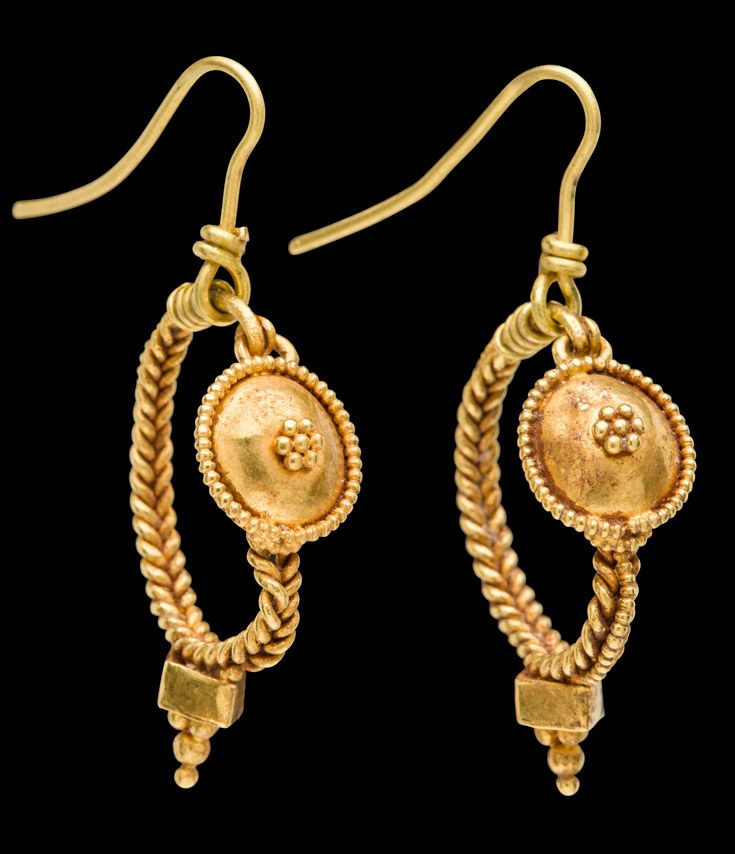 "Jewelry Auction - Nov 30th 2016 - Imperial Roman gold shield style earrings. Unusually finely made Imperial Roman gold shield style earrings with ""braided"" hoops of fused twisted wires, a third twisted wire fused to the exterior of the hoop. Central domed shield discs encirlced with twisted wire, a central cluster of granulation. Box shaped drops with granulated pyramids below. Intact, 1st - 2nd Centuries AD, Italy. This and more important art for sale on CuratorsEye.com"