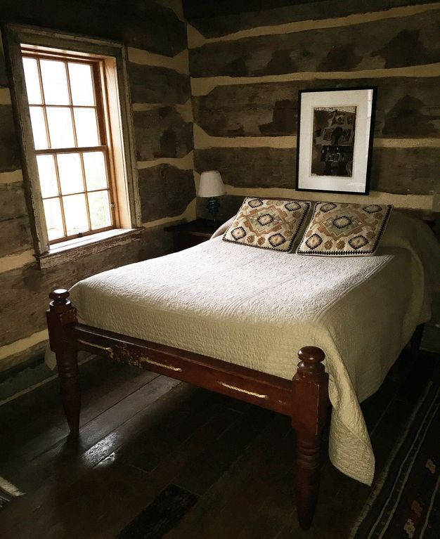 Full sized rope bed with contemporary mattress.
