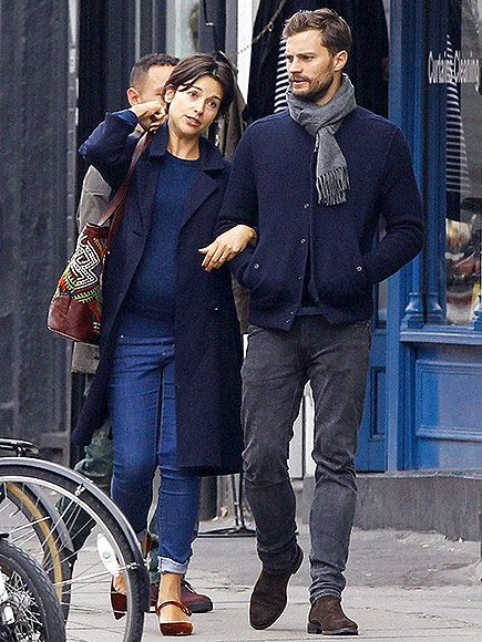 Jamie Dornan and Wife Amelia Cuddle Up During a Matching London Stroll http://www.people.com/article/jamie-dornan-amelia-warner-out-in-london