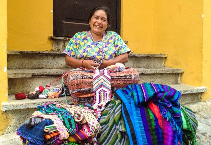 In Guatemala, Maria hand knits her own colorful fabrics and sells them to people passing by... with a smile! :)
