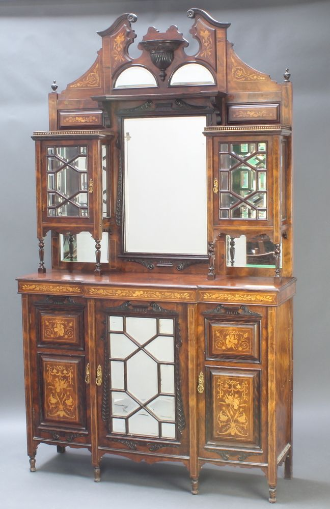 "Lot 938, A good Edwardian rosewood chiffonier sideboard, the raised back fitted a rectangular plate mirror flanked by a pair of cupboards enclosed by bevelled plate panelled doors, the base fitted a central cupboard enclosed by a bevelled plate mirror panelled door flanked by a pair of inlaid panelled doors, raised on turned feet 94""h x 54""w x 16""d est £500-800"