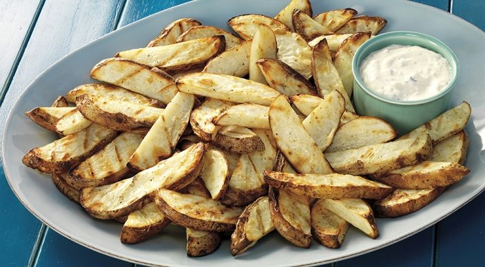 """Steak Fries with Rosemary-Lemon Aioli: """"Grill the potato slices over direct medium heat, with the lid closed, until tender and marked by the grill, 15 to 17 minutes, turning occasionally."""""""