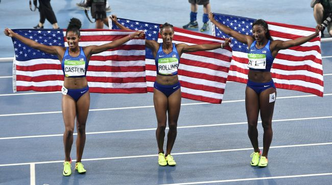 Gold medal winner United States' Brianna Rollins, center, silver medal winner United States' Nia Ali, right, and bronze medal winner United States' Kristi Castlin celebrate after the women's 100-meter hurdles final during the athletics competitions of the 2016 Summer Olympics at the Olympic stadium in Rio de Janeiro, Brazil, Wednesday, Aug. 17, 2016. (AP Photo/Martin Meissner)