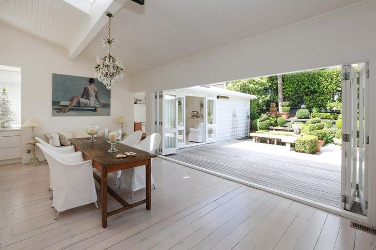 whitewashed wooden floors bifolds onto deck