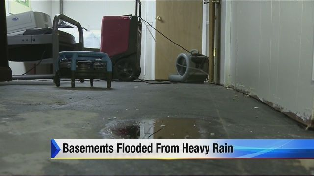 Basements flooded from heavy rain | News  - Home