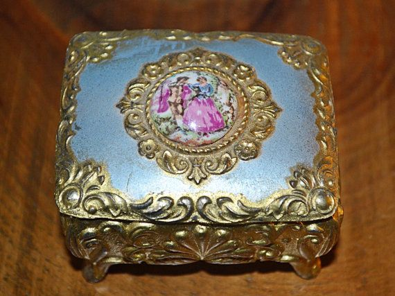 Check out this item in my Etsy shop https://www.etsy.com/ca/listing/497766063/vintage-trinket-box-courting-couple