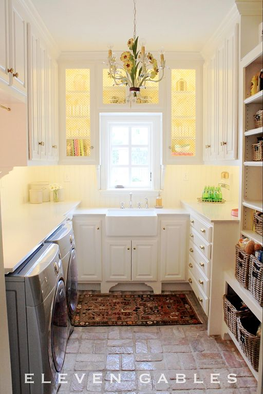 Combination pantry and laundry room off the kitchen. Notice a window replaces what was once a door, making room for the sink.