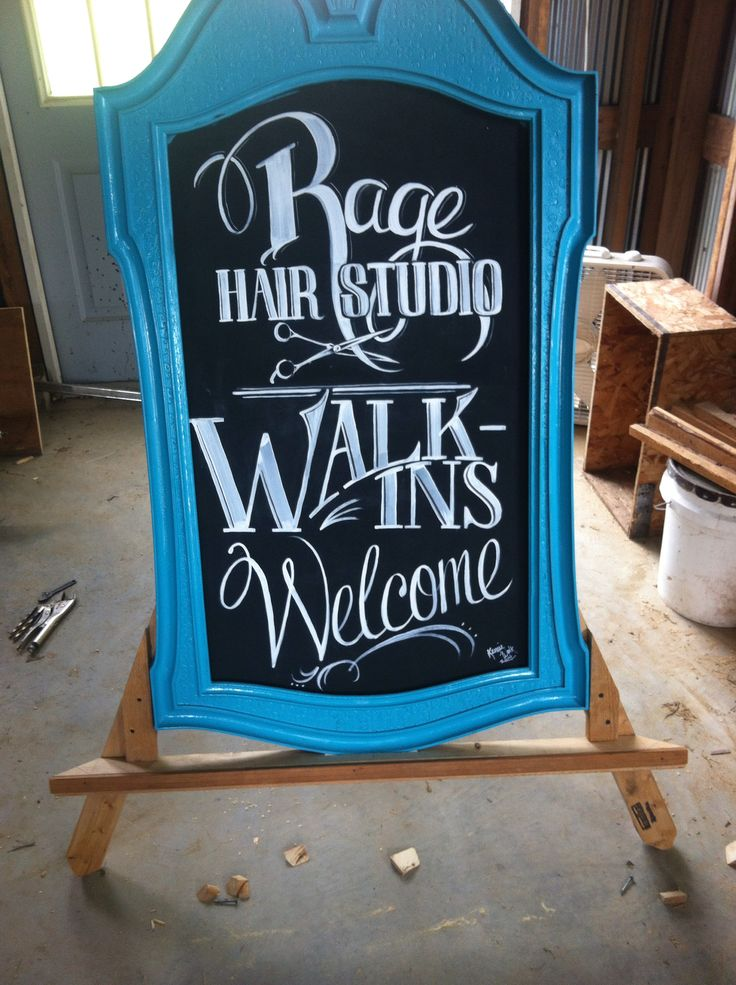 Old mirror turned sidewalk sign. Hair salon. Advertising. From trash to treasure. A frame. Chalkboard font lettering