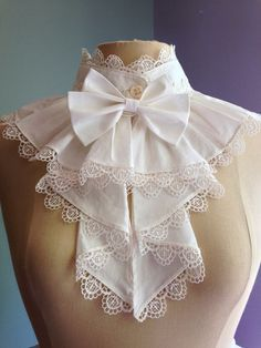 Jobot were introduced in 17th century. a decorative ruffle or other arrangement of lace or cloth attached at the neckline and extending down the front of a woman's blouse or dress or, formerly, of a man's shirt.