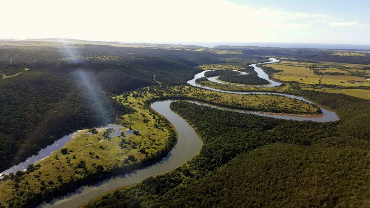 Magnificent aerial photo showing the meandering Kariega River. Sibuya Game Reserve guests enjoy a 45 minute boat ride with our trained rangers and see a multitude of birds and game on the cruise to our camps. Kenton on Sea, Eastern Cape, South Africa www.sibuya.co.za