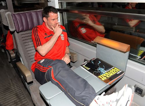 Carra strikes a pose en route to the Spanish capital to face Atletico Madrid