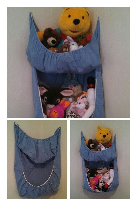 Pet net sheet. Nail an old crib sheet to the each wall in a corner where the elastic ends. Then put one nail in each wall through the sheet close to the angle of the wall pulling the center of the sheet up to make a pouch as seen. Then fill with toys