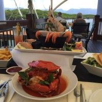 guest photos of local specialties, the whole mudcrab, and chilled seafood platter for two. On The Inlet Seafood platter, Port Douglas