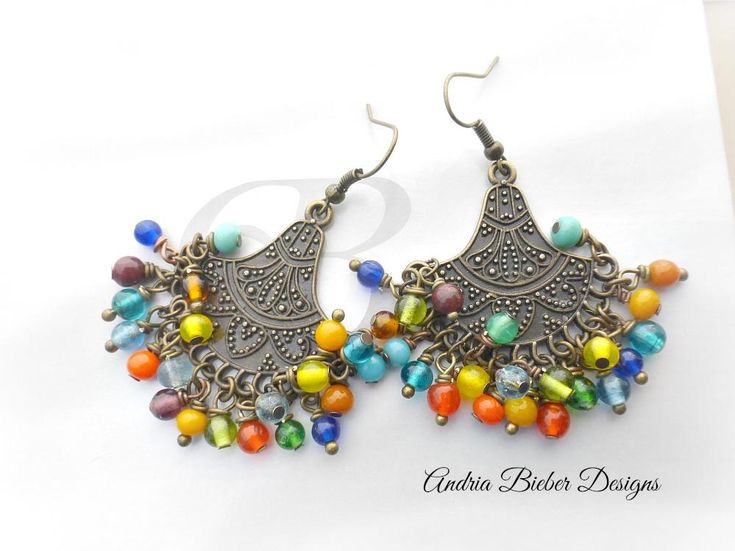 Cha Cha. Wire wrapped round glass beads and bronze metal earrings.