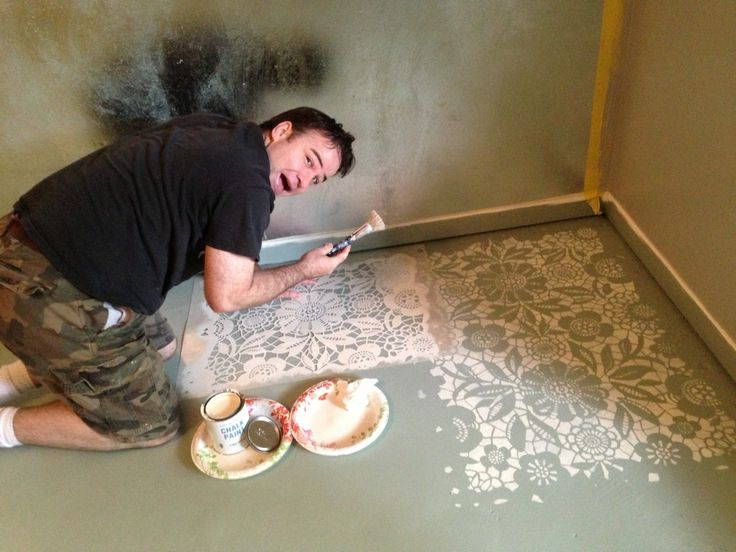 Brooks painting the Skylars Lace Stencil in Old White painted floor with chalk paint