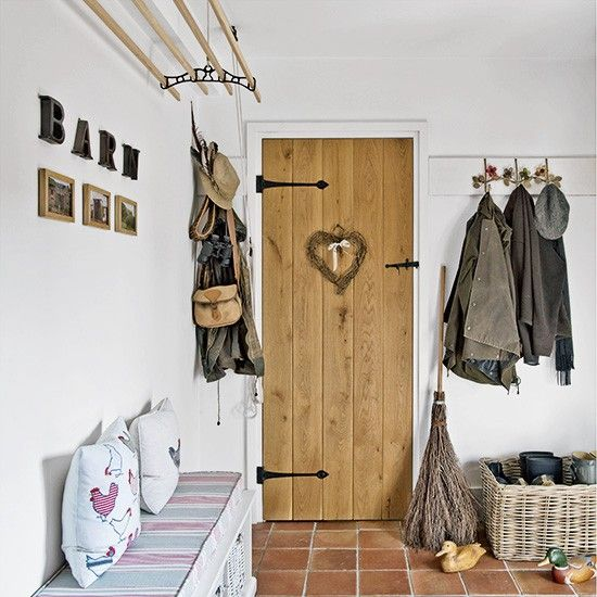 Country-cottage style hallway with smart storage