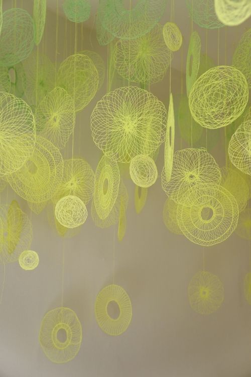 Textiles artist Amanda McCavour creates air suspended installations using repeated stitching and free embroidery on dissolvable fabric. http://www.amandamccavour.com/