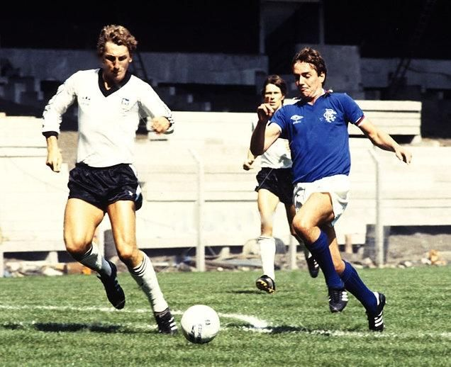 Terry Butcher of Ipswich Town and Ian Redford of Rangers, watched by Ipswich's Arnold Muhren.