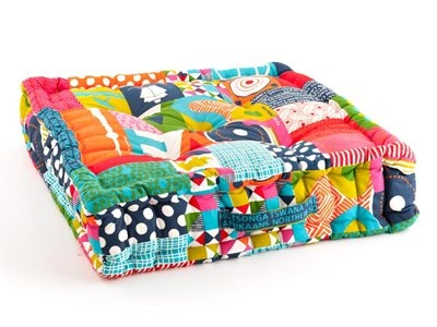 South African themed multicoloured cushion covers add a splash of colour.