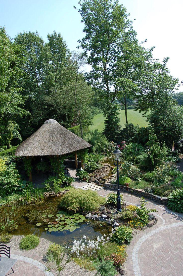 Bestratingen Japanse tuin Natuurlijke vijver met trap Pergola's Schanskorven Strakke moderne stijl met vijver Overige