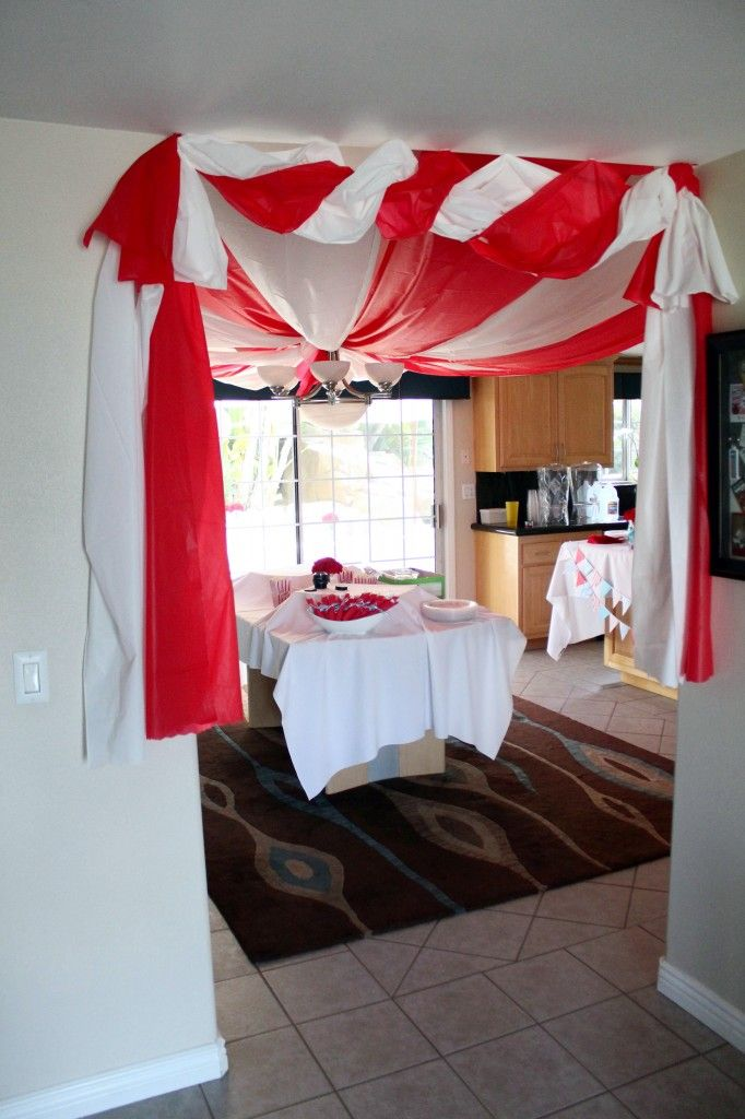Circus theme with cheap plastic tableclothes.... Perfect for on the gazebo frame!!