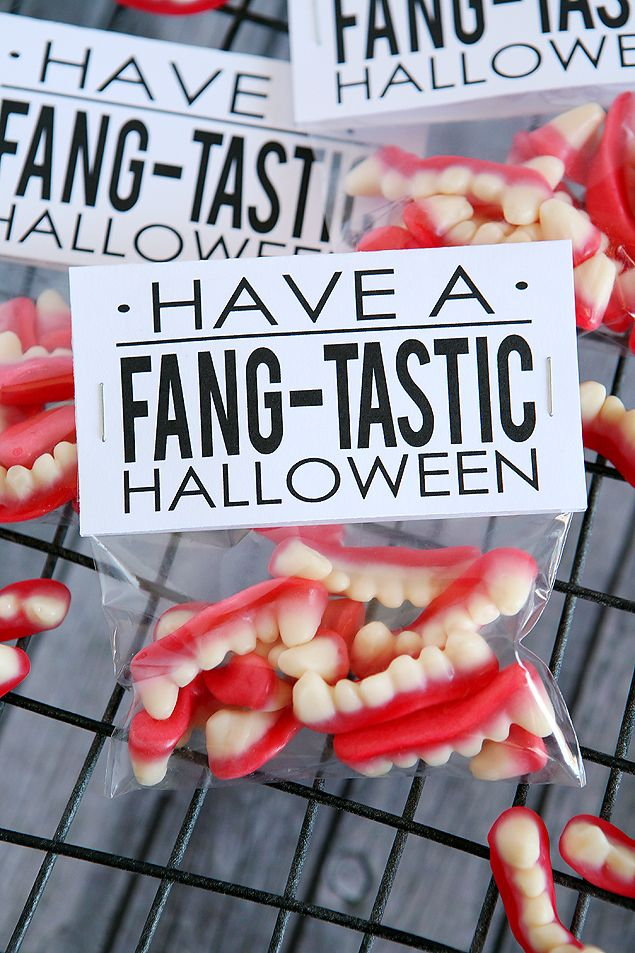 """Have a Fang-tastic Halloween. Such a fun Halloween gift idea!It just dawned on me that these would be really fun to give to your kids when you go see the new Hotel Transylvania movie. We just went and saw it last weekend and it's super cute and all about Fangs! *Gummy Fangs found at Target *4×6 cellophane bags *Stapler *free printable: """"Have a FANG-tastic Halloween Tags"""