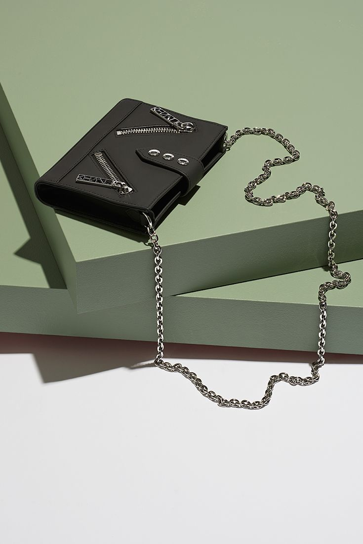 This Kenzo handbag gives your style just the right amount of attitude.
