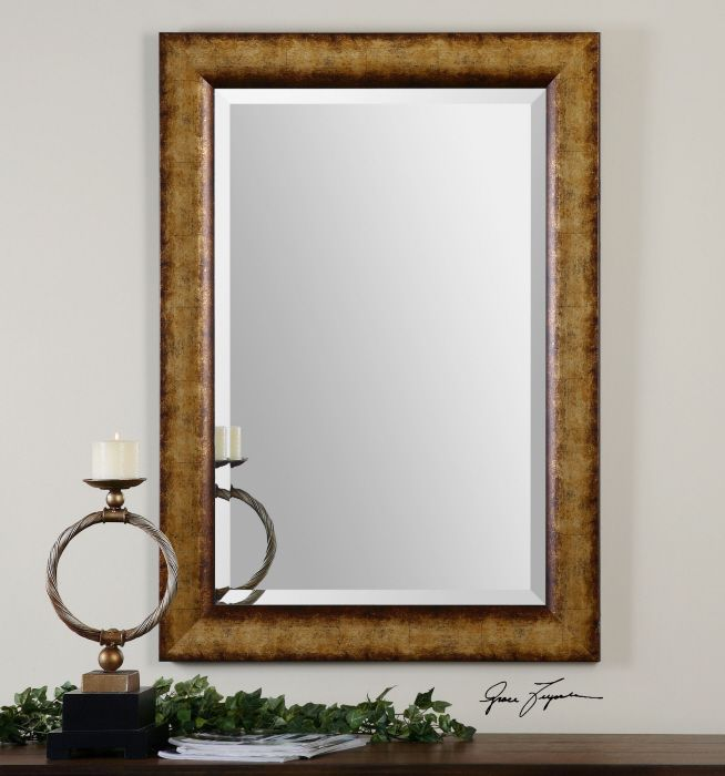 uttermost cullen mirror frame features a heavily burnished champagne gold finish with a generous - Uttermost Mirrors