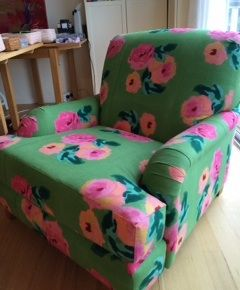 Gorgeous hand block printed fabric by Lisa Corti turns this vintage chair into a statement piece.