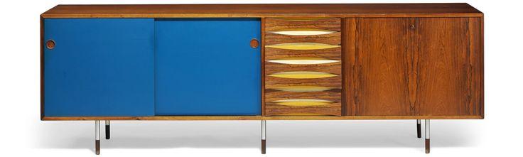 "Arne Vodder // Model 29A // ""Credenza"". Freestanding Brazilian rosewood sideboard on six steel legs, reversible sliding doors. H. 80 cm. L. 250 cm. D. 47 cm."