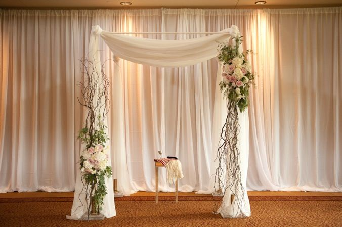 Chuppah- using totally different flowers and no curly willow or any branches, I like the location of the floral accents- not matching, keeps it interesting and different.