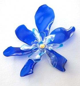 Plastic bottle flowers....made from bottles, colored with sharpie (if desired), melted with flame and hot glued together