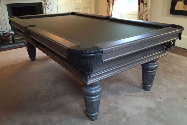 This is a 7' Traditional Pool Table in our Oak 13 wood colour, with a Hainsworth Smart Black cloth.  Found on our website: www.Luxury-Pool-Tables.co.uk