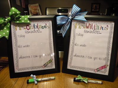 Whiteboard picture frame reminders for the teacher and assistant via First Grade Fever!
