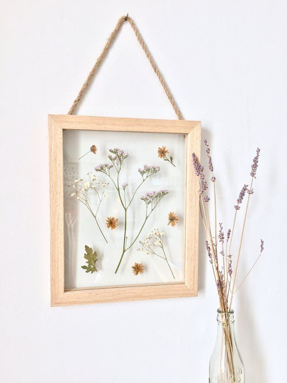 Hanging Wooden Frame Displaying A Variety Of Pressed Flowers Including Babys Breath And Sea Lavender Chunky J Trending Decor Pressed Flowers Framed Botanicals