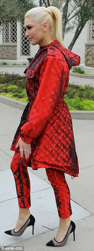 So much red: The Hollaback Girl singer showed off her shade along with her black heels...