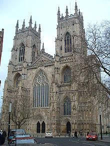 York Minster is a Gothic cathedral in York, England and is one of the largest of its kind in Northern Europe. Building began in 1220 and continued into the 15th century. The cathedral was declared complete and consecrated in 1472. The western front is shown above.
