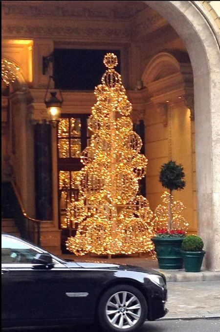 How cool is this and so easy to recreate, make chicken wire balls or string balls add lights around it and hang from a pole in shape of a tree!  Love!  Christmas in Paris