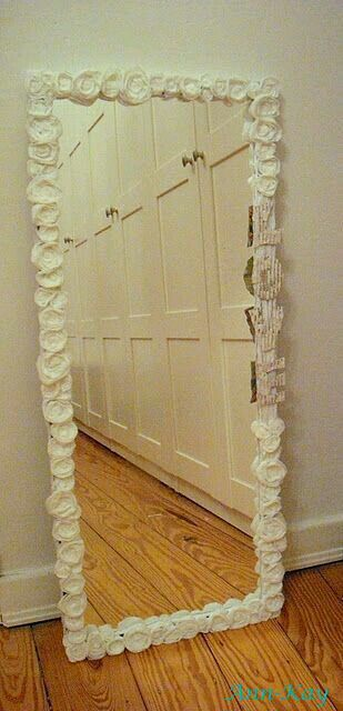 Buy plain mirror, hot glue flowers (i would do pinks, whites and purples) with some pearls and lace to make it shabby chic.   G;)