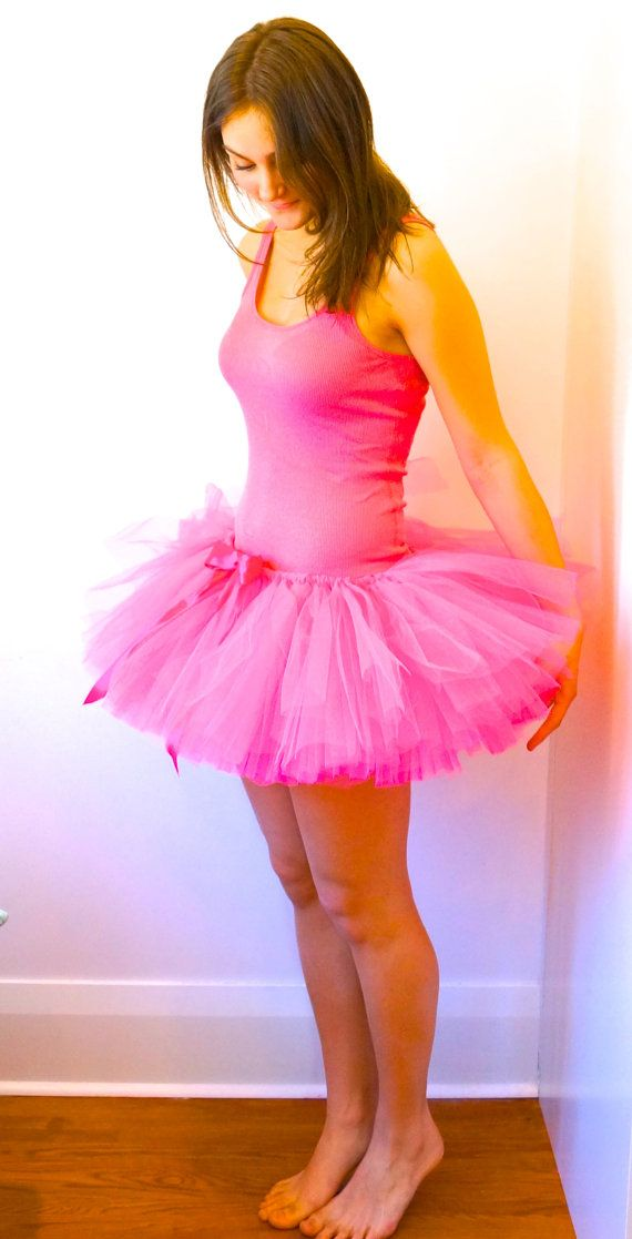 This beautiful handmade Hot Pink tutu is made with yards of gorgeous tulle and ribbon. It is very adjustable and will fit most. Include your pant