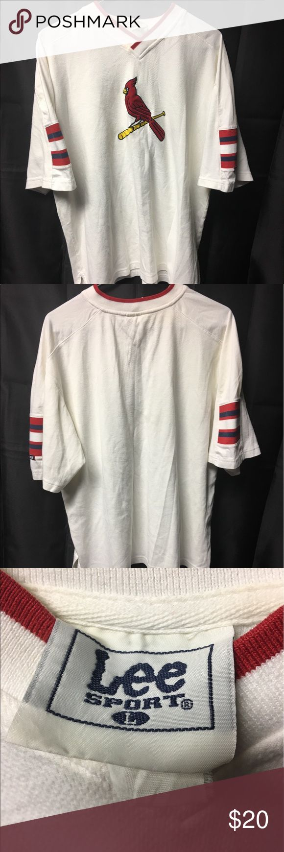 Vintage St. Louis Cardinal V Neck Teeshirt Gently Worn Men's Large St. Louis Cardinals V Neck Teeshirt. Shirt features Cardinals Logo sewn in on the chest. In excellent condition with no major flaws. Lee Shirts Tees - Short Sleeve