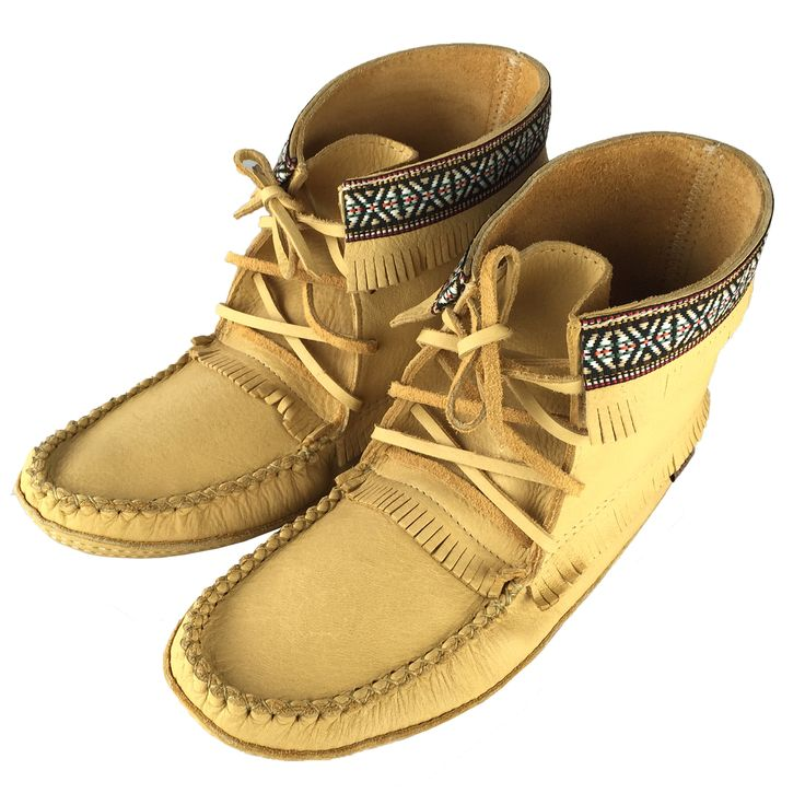 - Description - Details - Sizing - These men's moccasin boots are stylish and comfortable while keeping a classic and authentic Native Indian look. They are ankle-high and feature a Native American br