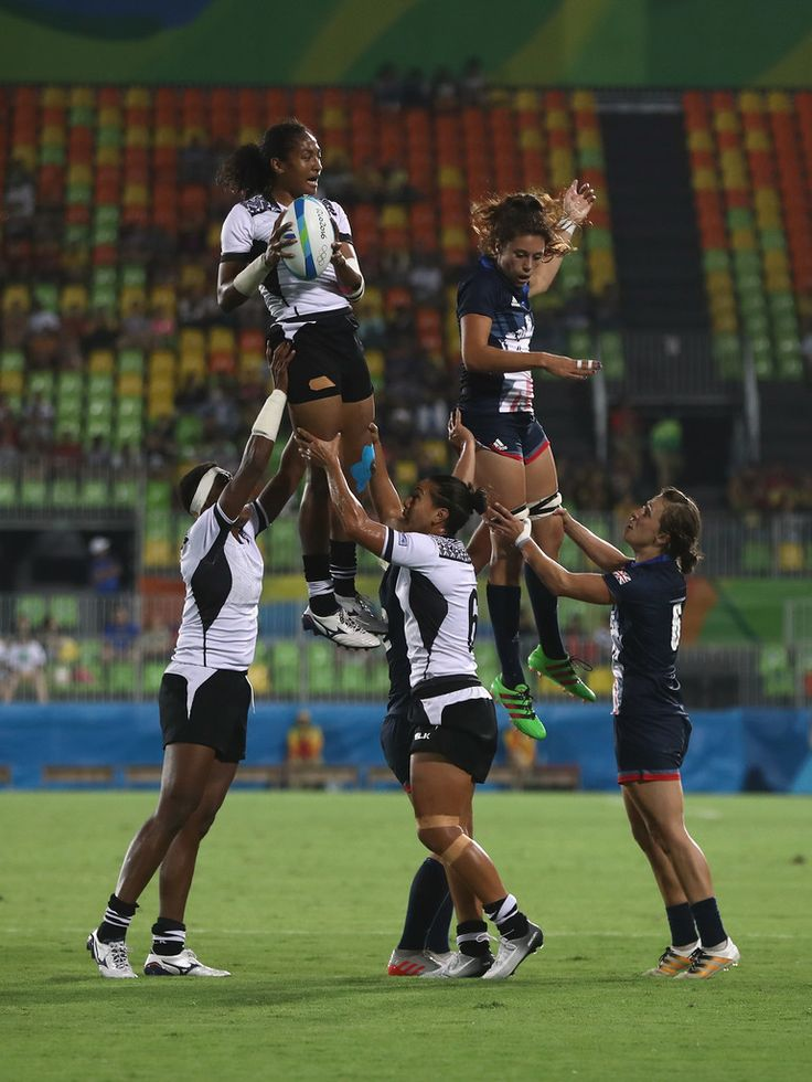 Tima Tamoi of Fiji handles the ball in a line-out as Abbie Brown of Great Britain defends during the Women's Quarterfinal rugby match on Day 2 of the Rio 2016 Olympic Games at Deodoro Stadium on August 7, 2016 in Rio de Janeiro, Brazil.