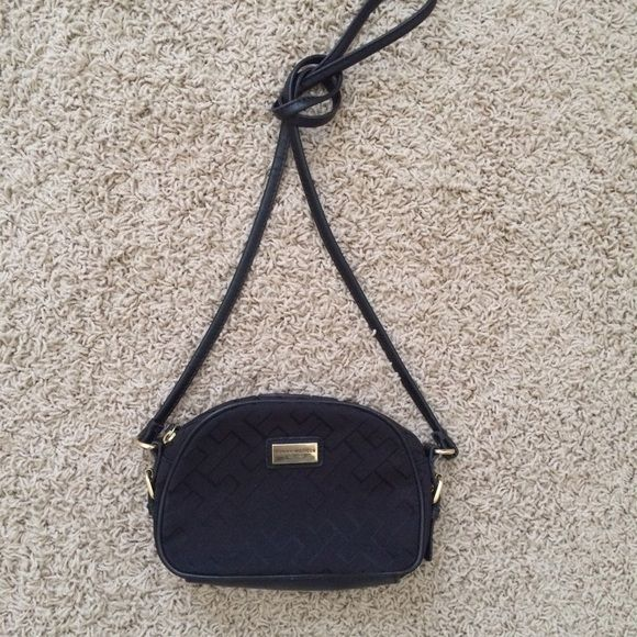 Tommy Hilfiger Cross-body Black with gold accents, barely used cross-body with roughly 2 ft hang from shoulder to top of bag. In great condition. Chain is not detachable from the body of the bag. Tommy Hilfiger Bags Crossbody Bags