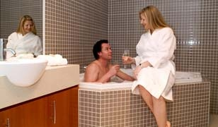 Couple enjoying corner spa- Executive Apartment