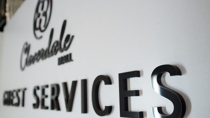 """Guest Services Sign designed for Cloverdale Mall. Fabricated of Brushed Aluminum laminate with 1/2"""" thick black acrylic letters with a high gloss finish."""