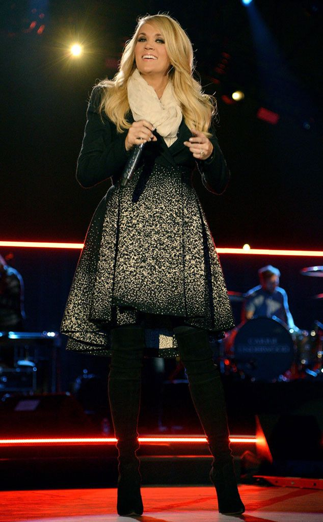 All Bundled Up from Carrie Underwood's Pregnancy Style  The singer looks pre-performance pretty in Washington D.C., wearing an embellished LBD, cream-colored scarf and black tights.